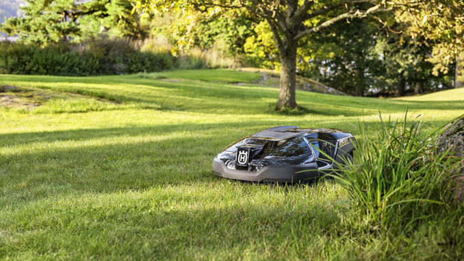 Robotic mowers can be a big time saver in your landscape, giving you more time to tend to the garden. Image: Husqvarna.